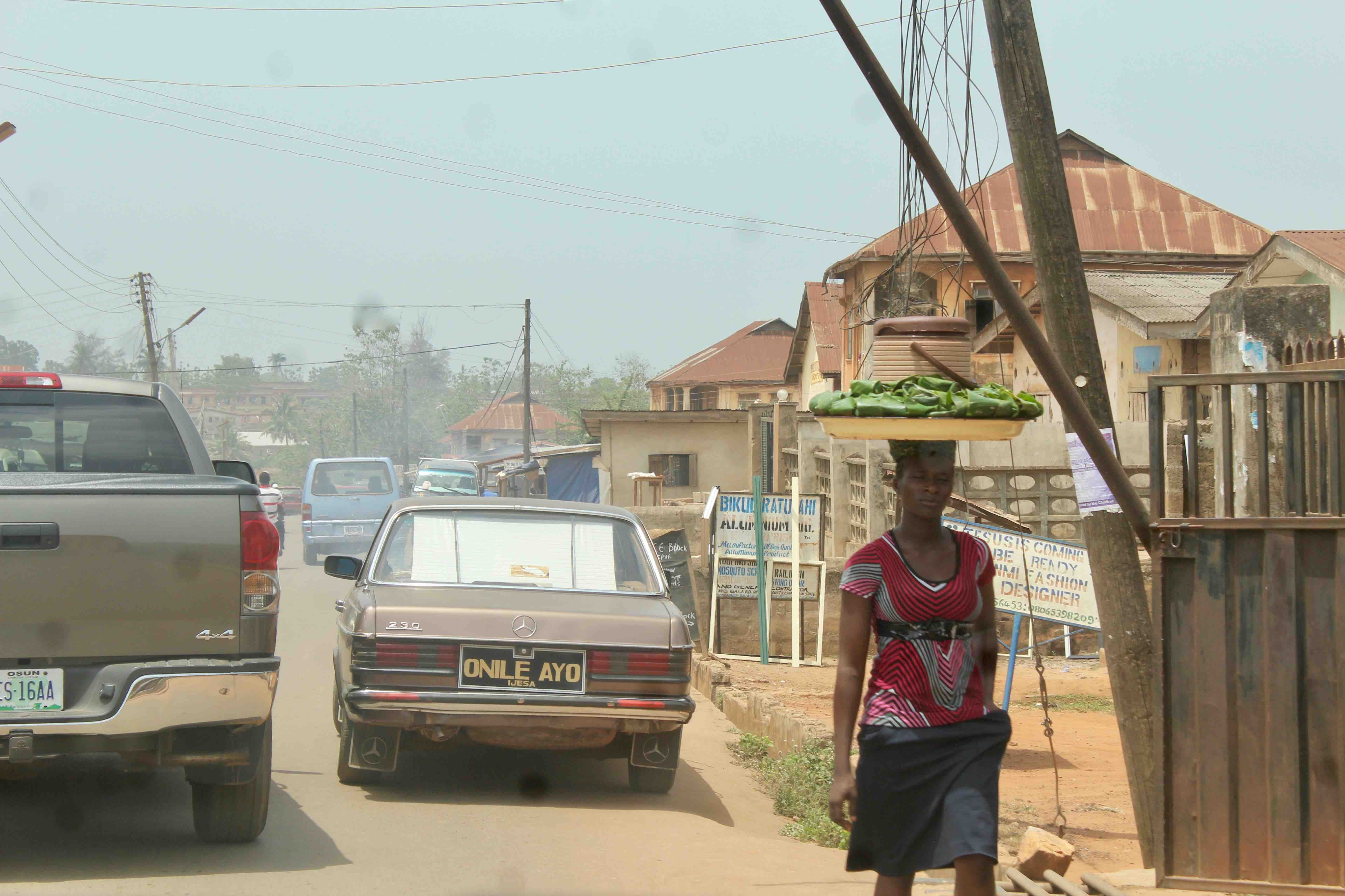 Woman street hawking eko in Ilesa, Osun State, Nigeria. #JujuFilms