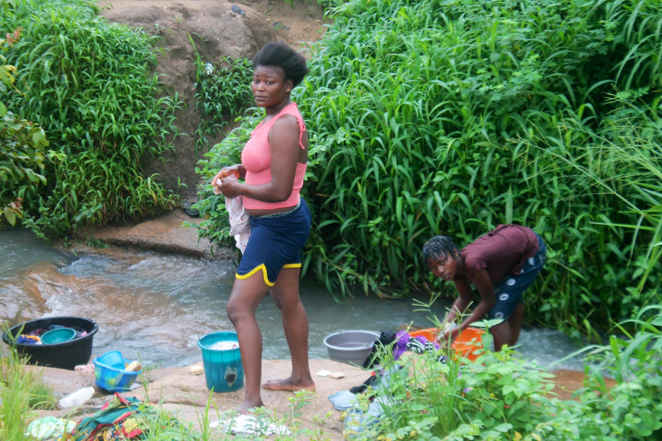 Women washing clothes by the river, Ushafa Village, FCT, Abuja, Nigeria. #JujuFilms