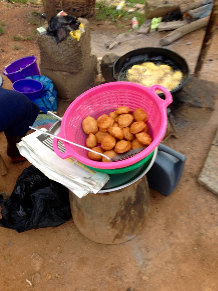 Woman frying akara and African yams in Dutse, FCT, Abuja, Nigeria. #JujuFilms