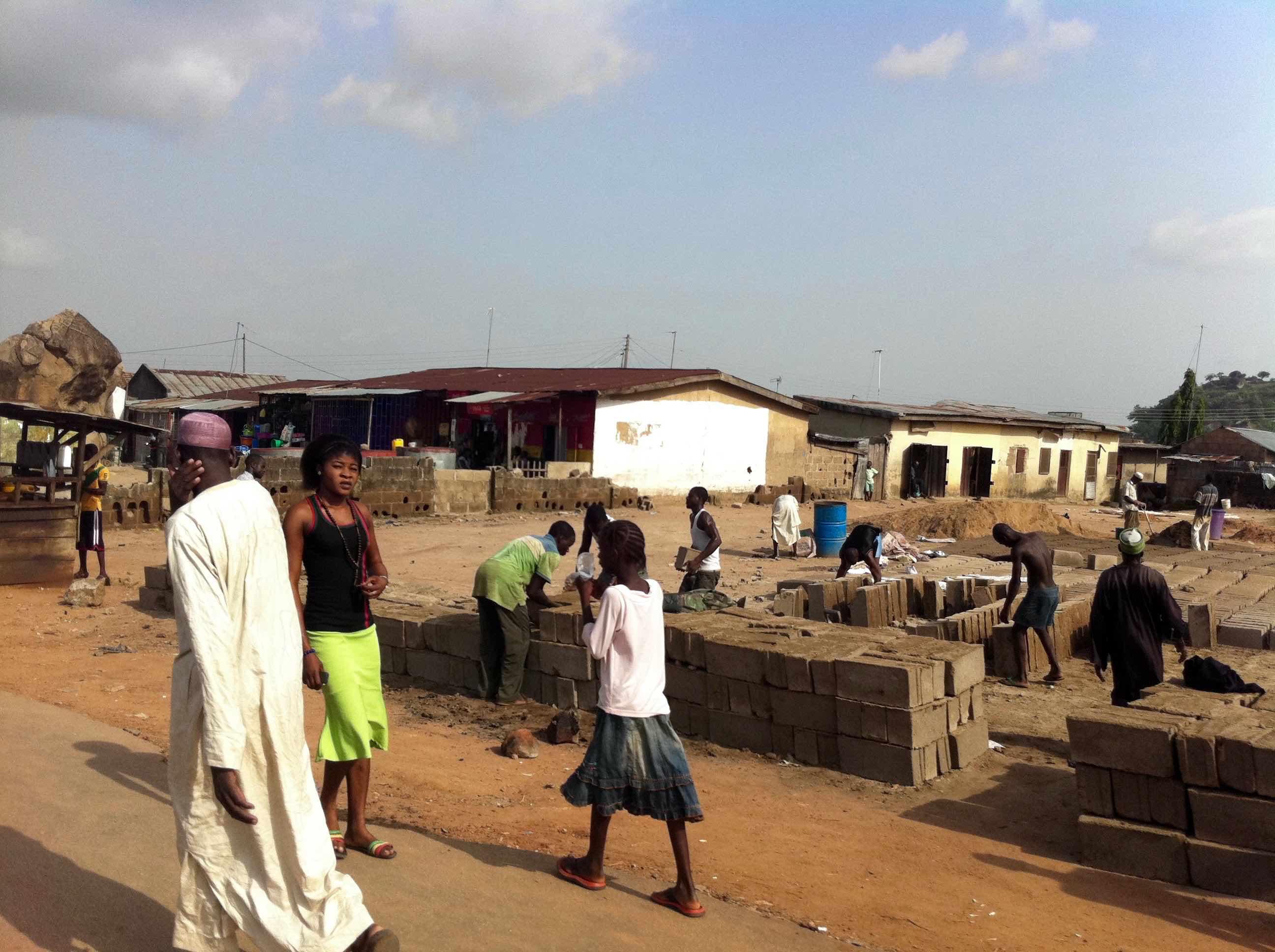 Moulding building blocks in Suleja, Niger, Nigeria. #JujuFilms