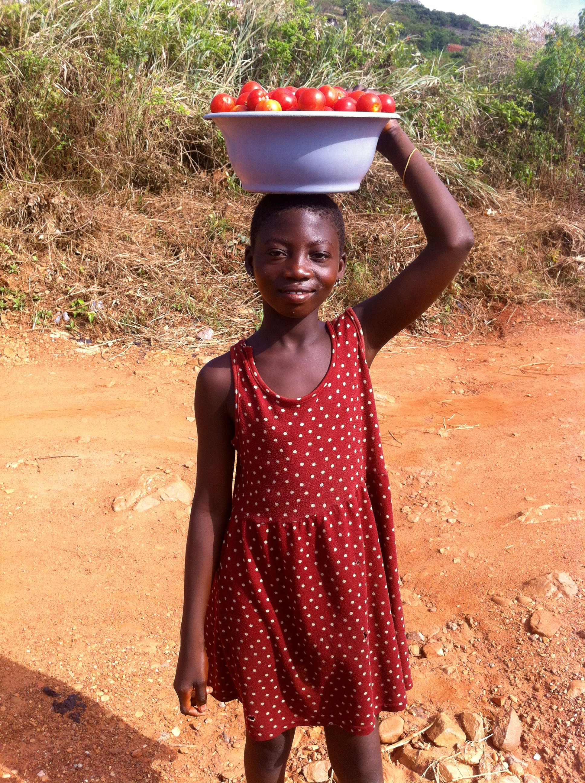 Eunice street hawking tomatoes in Kokrobite, Ghana. #JujuFilms