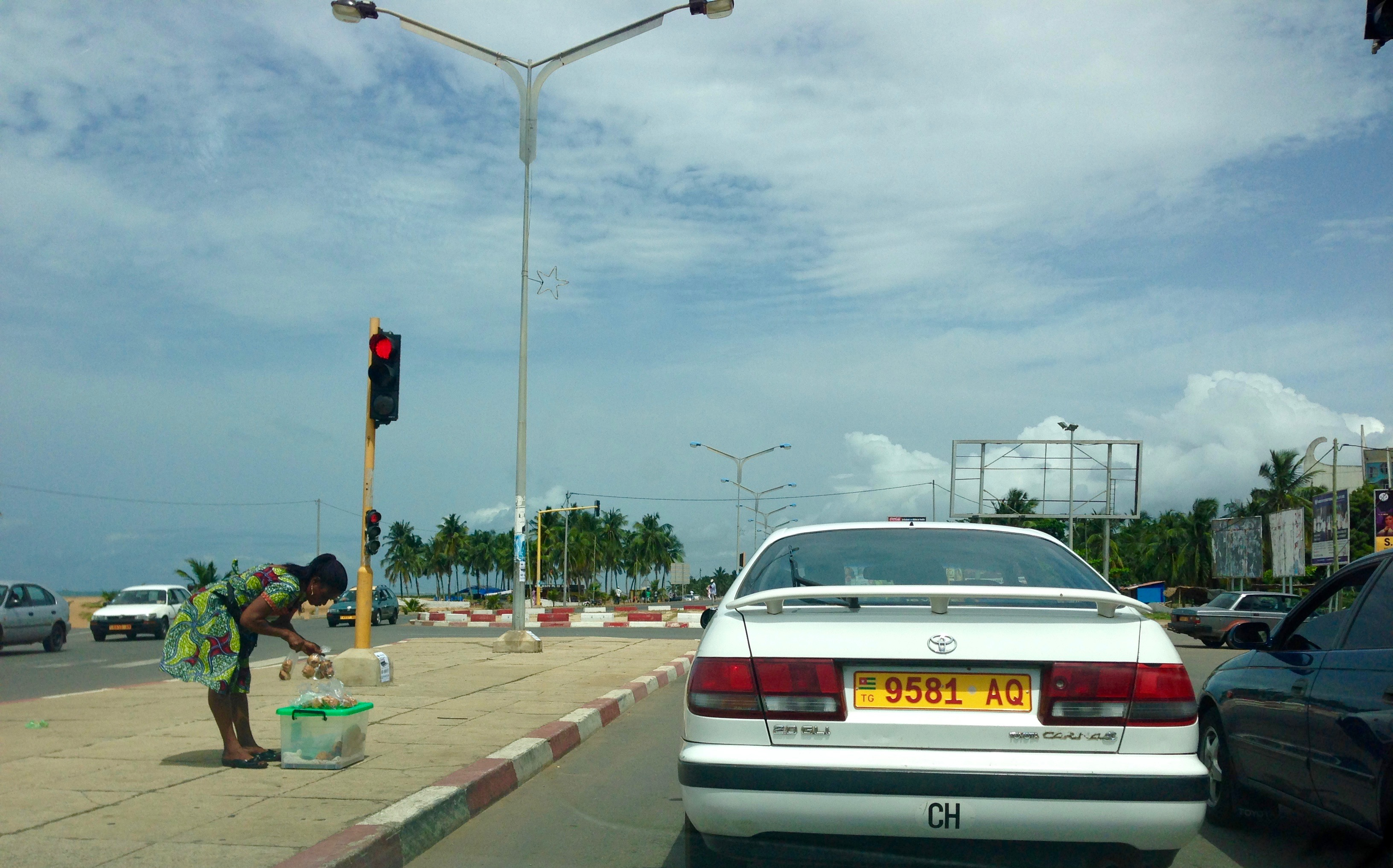 Woman roadside hawking, Lome, Togo. #JujuFilms