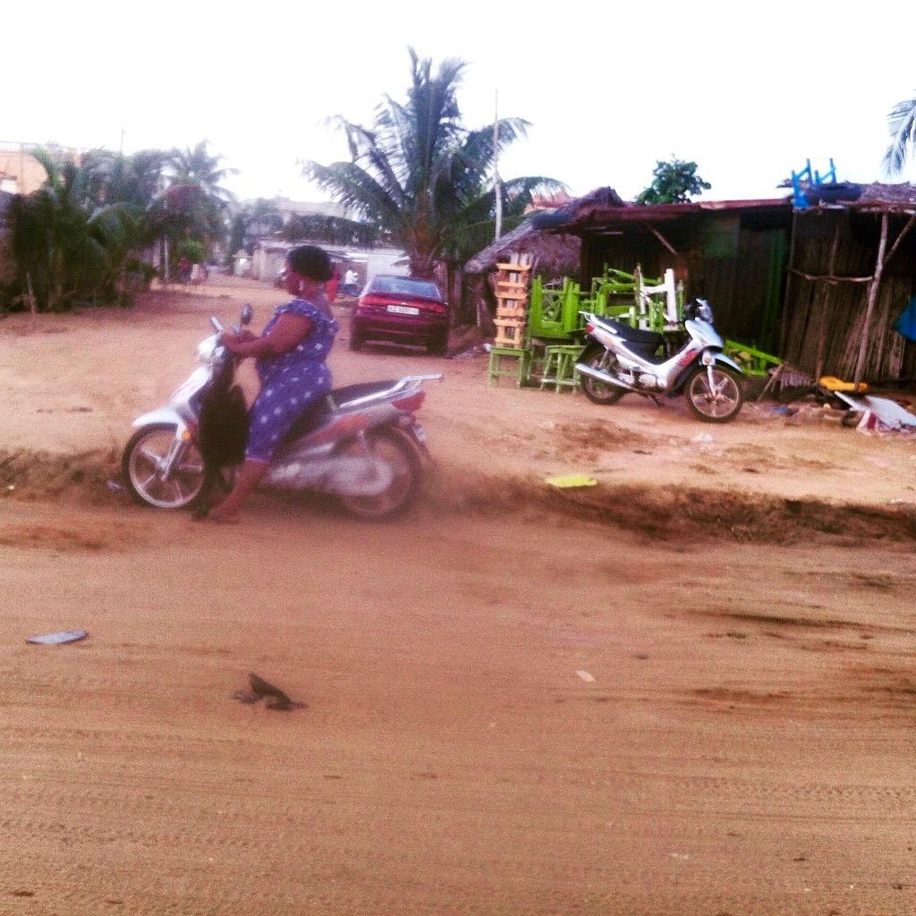 Woman motorcycling, Fidjrosse Beach, Cotonou, Benin. #JujuFilms