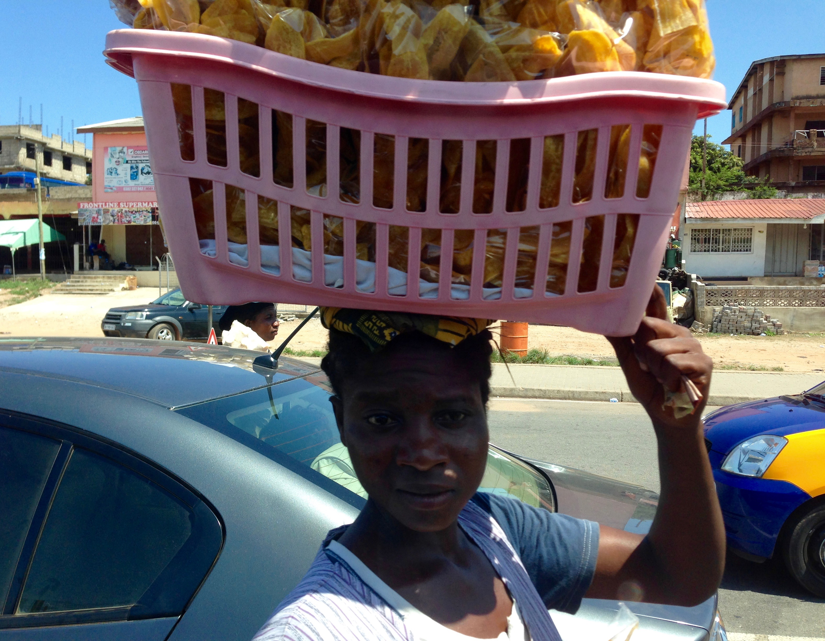 Woman hawking plantain chips in Nima, Accra, Ghana. #JujuFilms