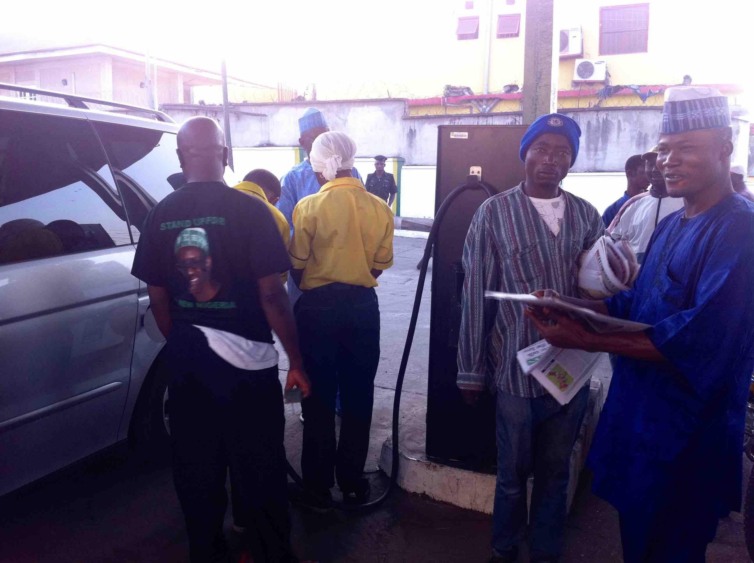 Newspaper vendor @ AP Gas Station in Okene, Kogi, Nigeria. #JujuFilms