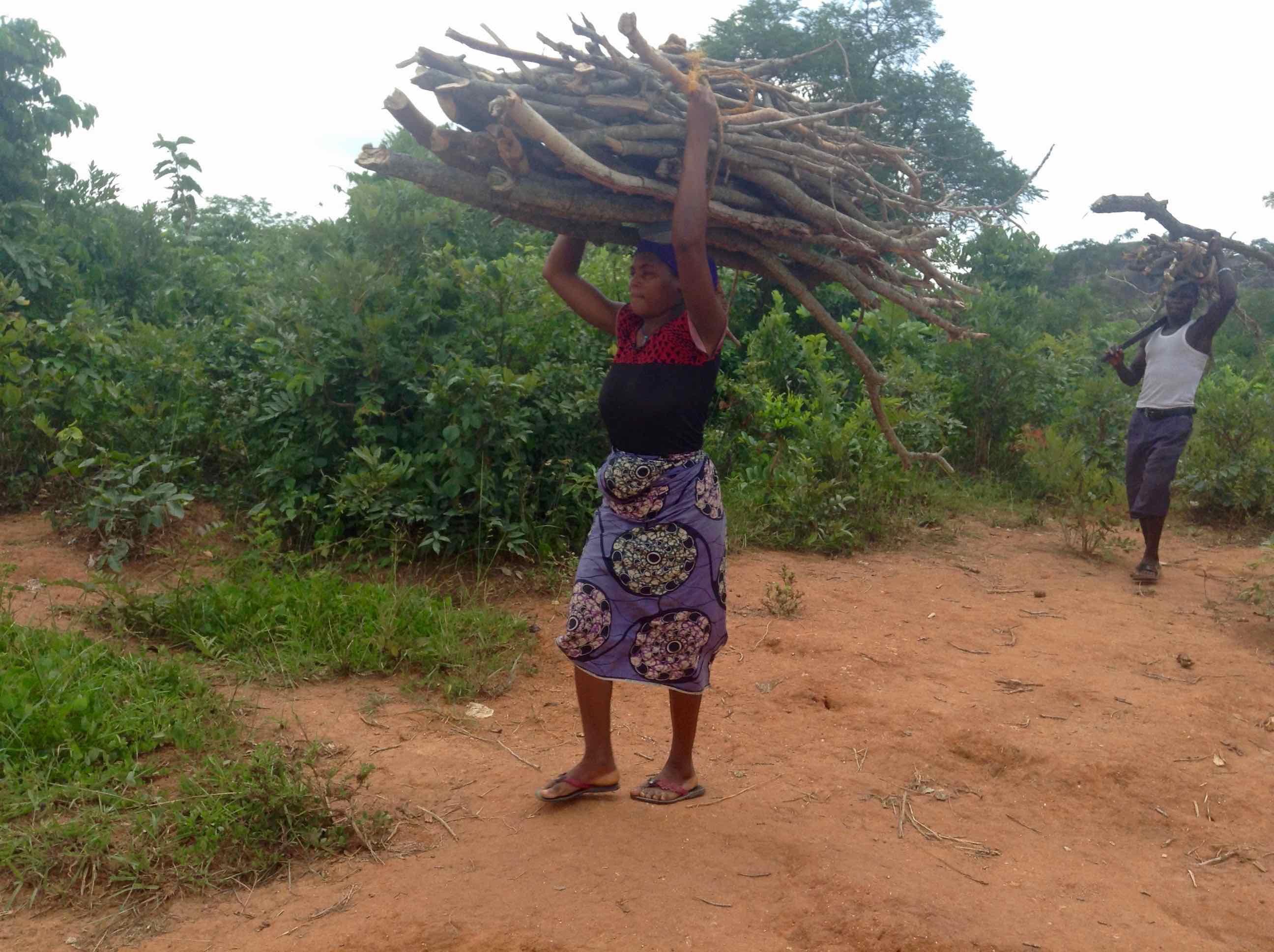 Gbagyi Woman and man fetching firewood in Ushafa Village, FCT, Nigeria, #JujuFilms