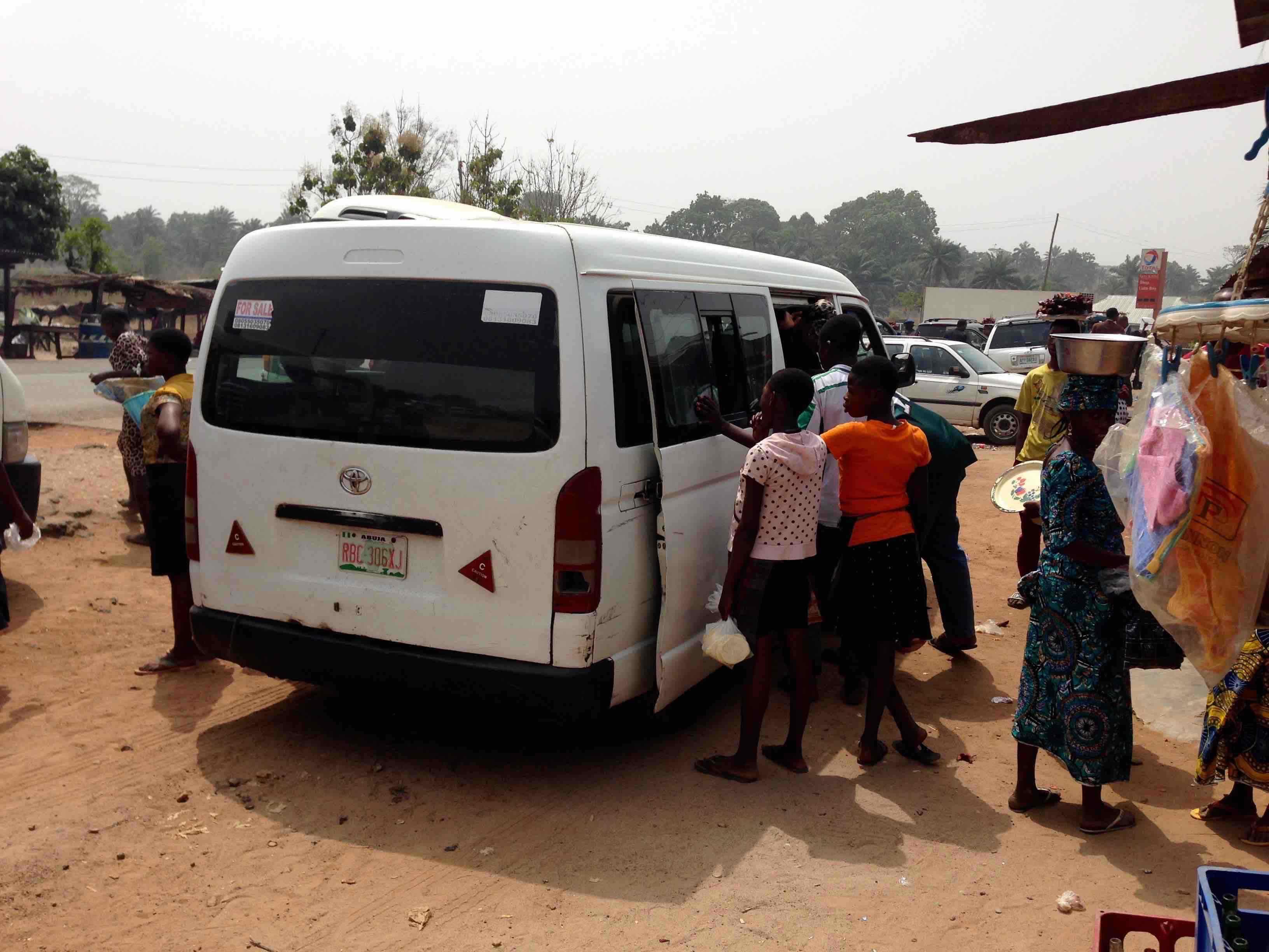 Women and young girls roadside hawking food in Ibillo, Edo, Nigeria. #JujuFilms