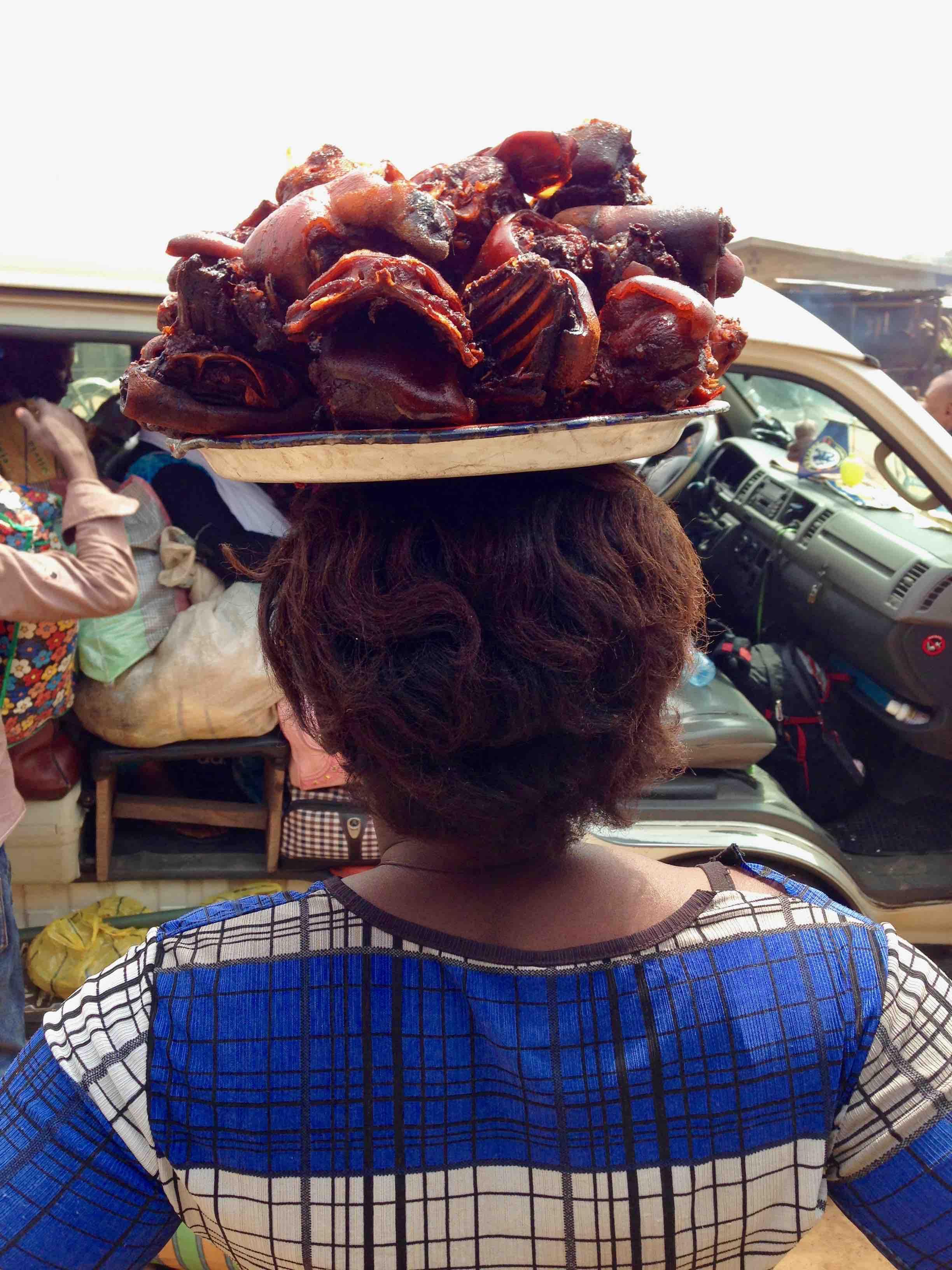 Woman hawking bushmeat in Ibillo, Edo, Nigeria. #JujuFilms