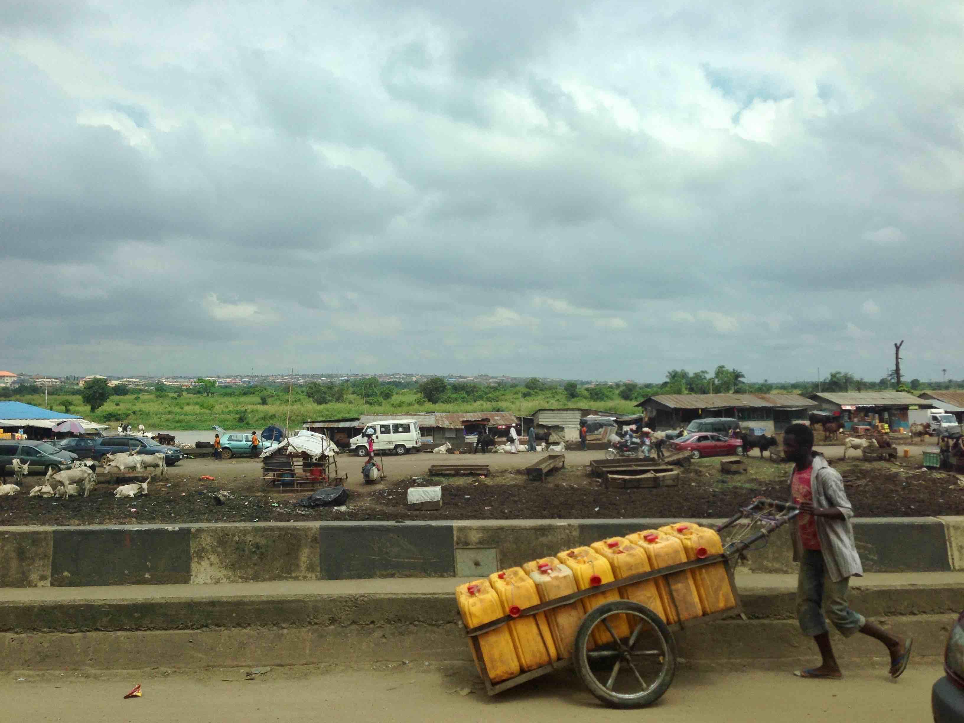 Street hawking water in Lagos, Nigeria. #JujuFilms