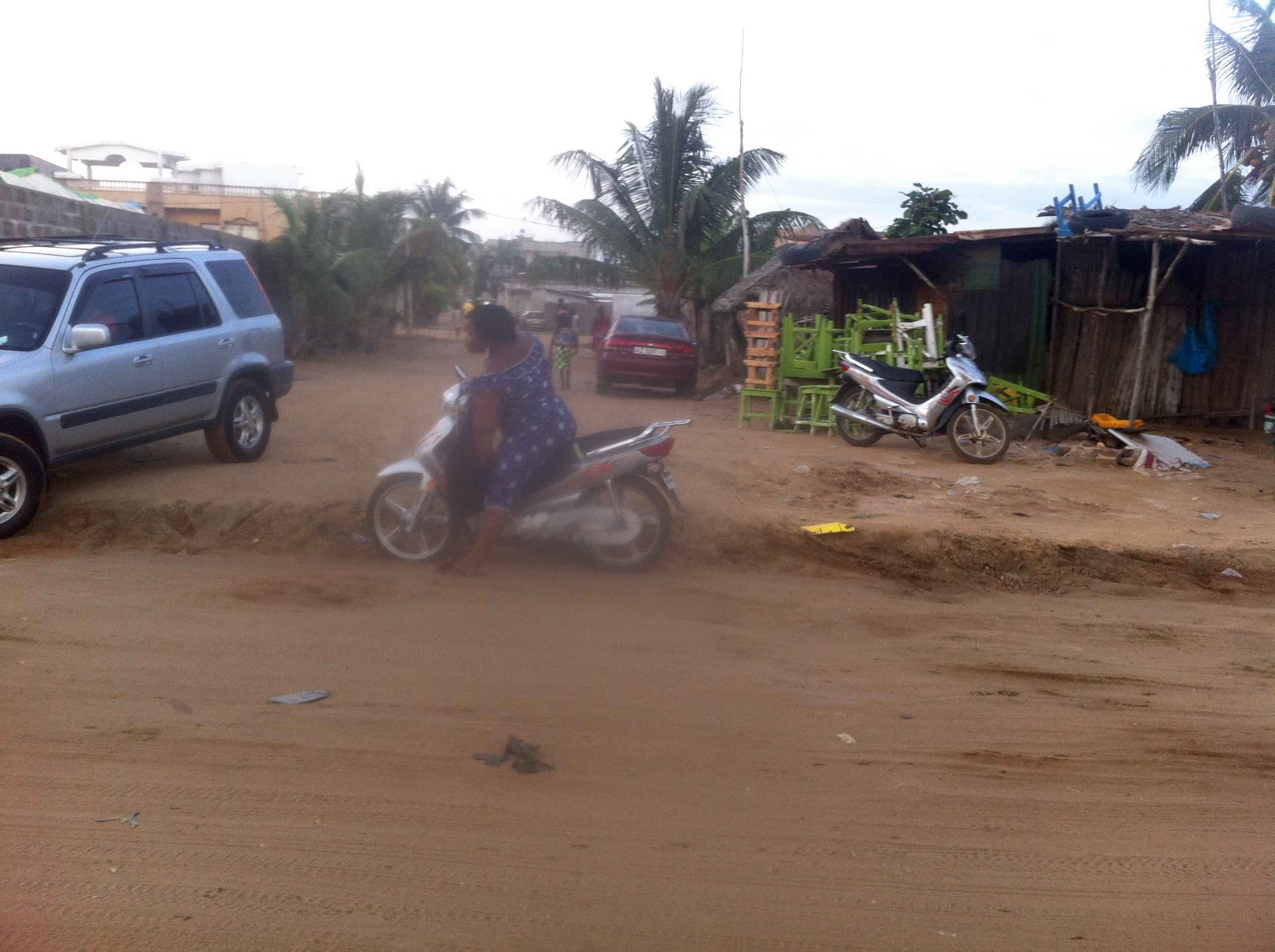 Female motorcyclist in Fidjrosse Beach, Cotonou Cadjehon Airport, Littoral Department, Benin. #JujuFilms