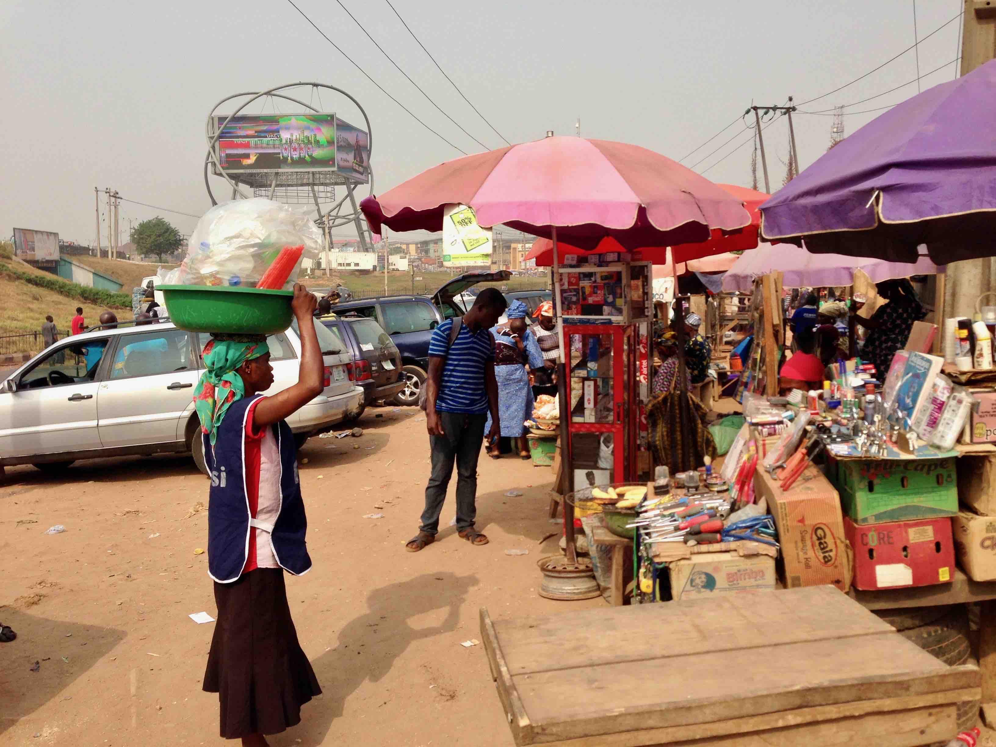 Woman hawking drinks, Motor Park, Iwo Road, Ibadan, Oyo State, Nigeria. #JujuFilms