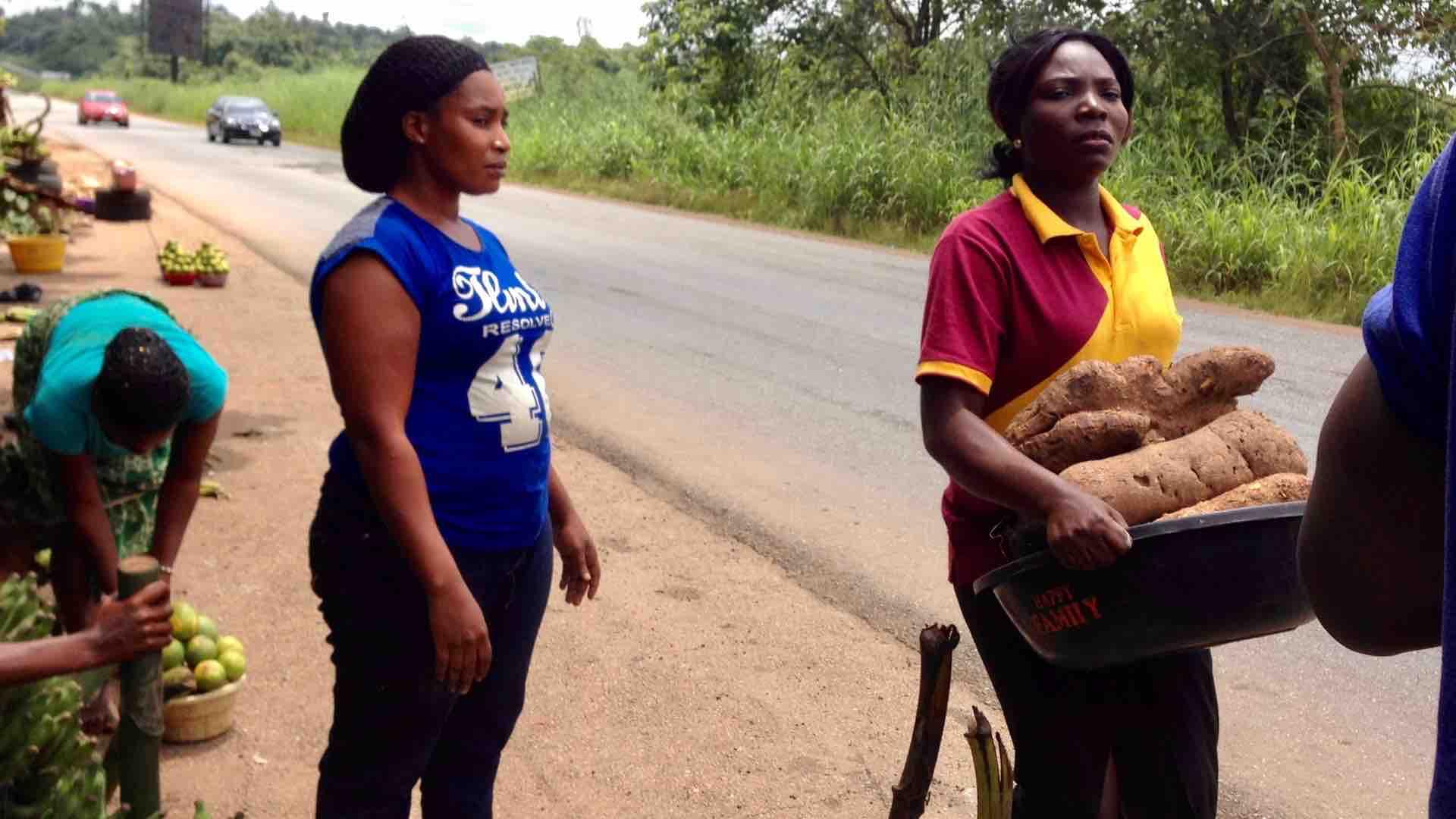 Ijesha women roadside hawking African yams on Ilesa - Ibadan Expressway, Osun State, Nigeria. #JujuFilms