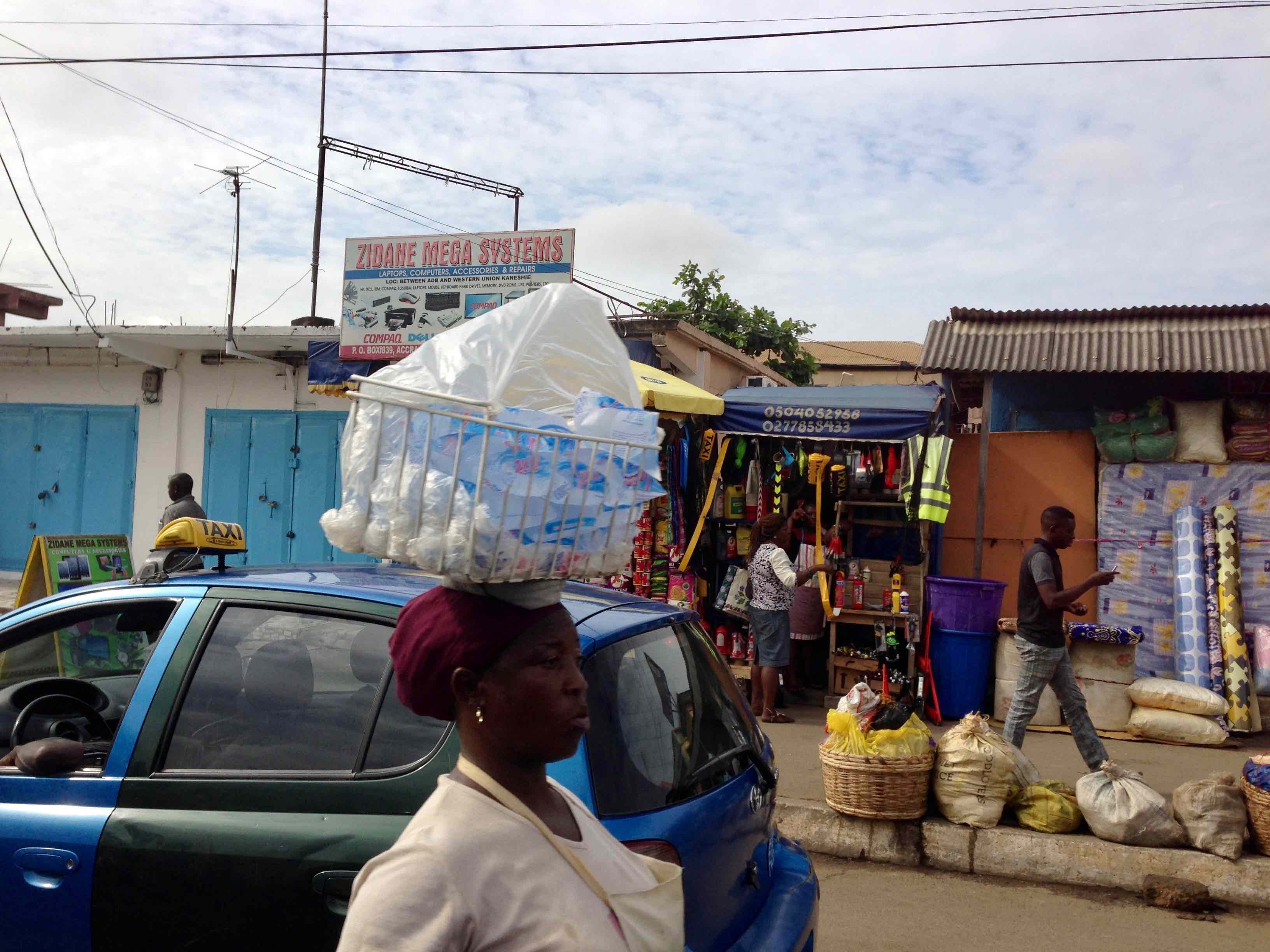 Woman street hawking water on Winneba Road, Accra, Ghana. #JujuFilms