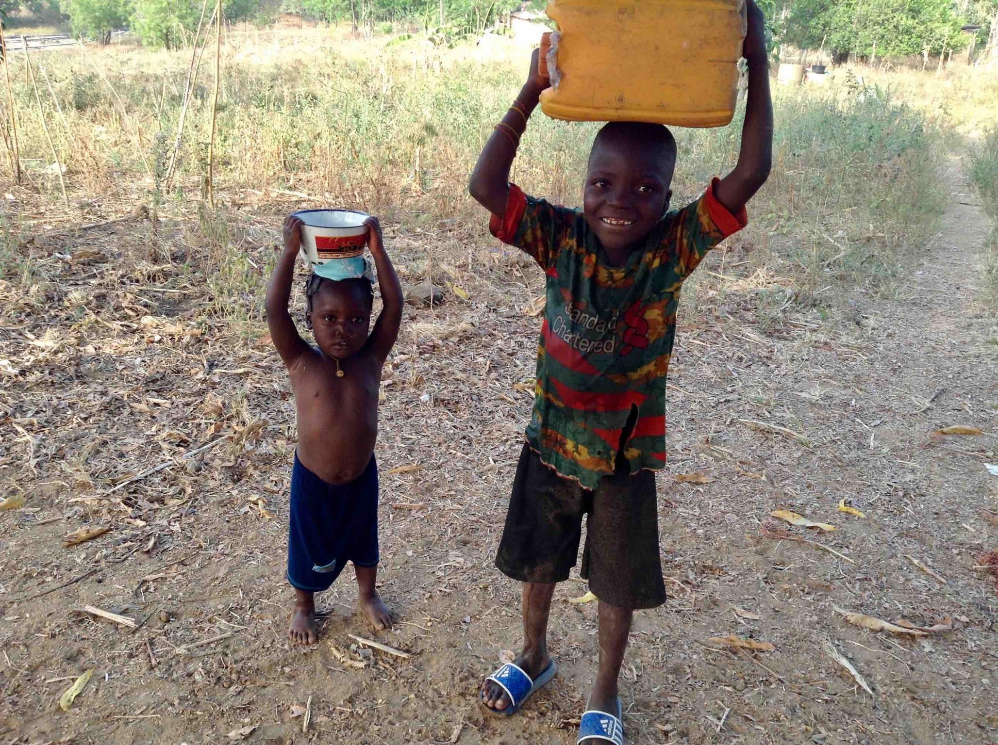 Eggon children fetching water in Langa Langa Village, Nasarawa State. Nigeria. #JujuFilms