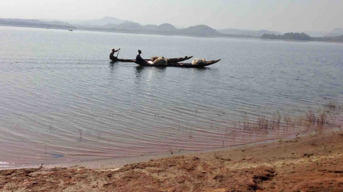 Fishermen canoeing on Usuma Lake, Ushafa, FCT, Abuja, Nigeria. #JujuFilms