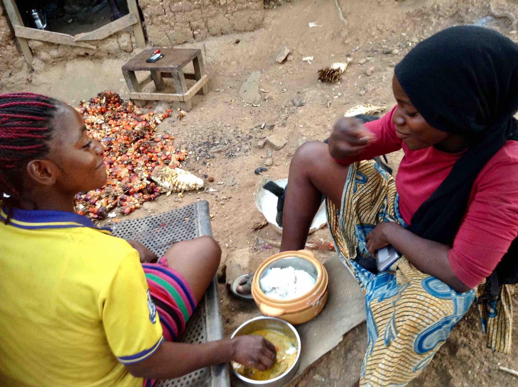 Eggon girls (Jumai) and (Awayi) eating lunch, ground rice and egusi soup, Langa Langa Village, Nasarawa State, Nigeria. #JujuFilms