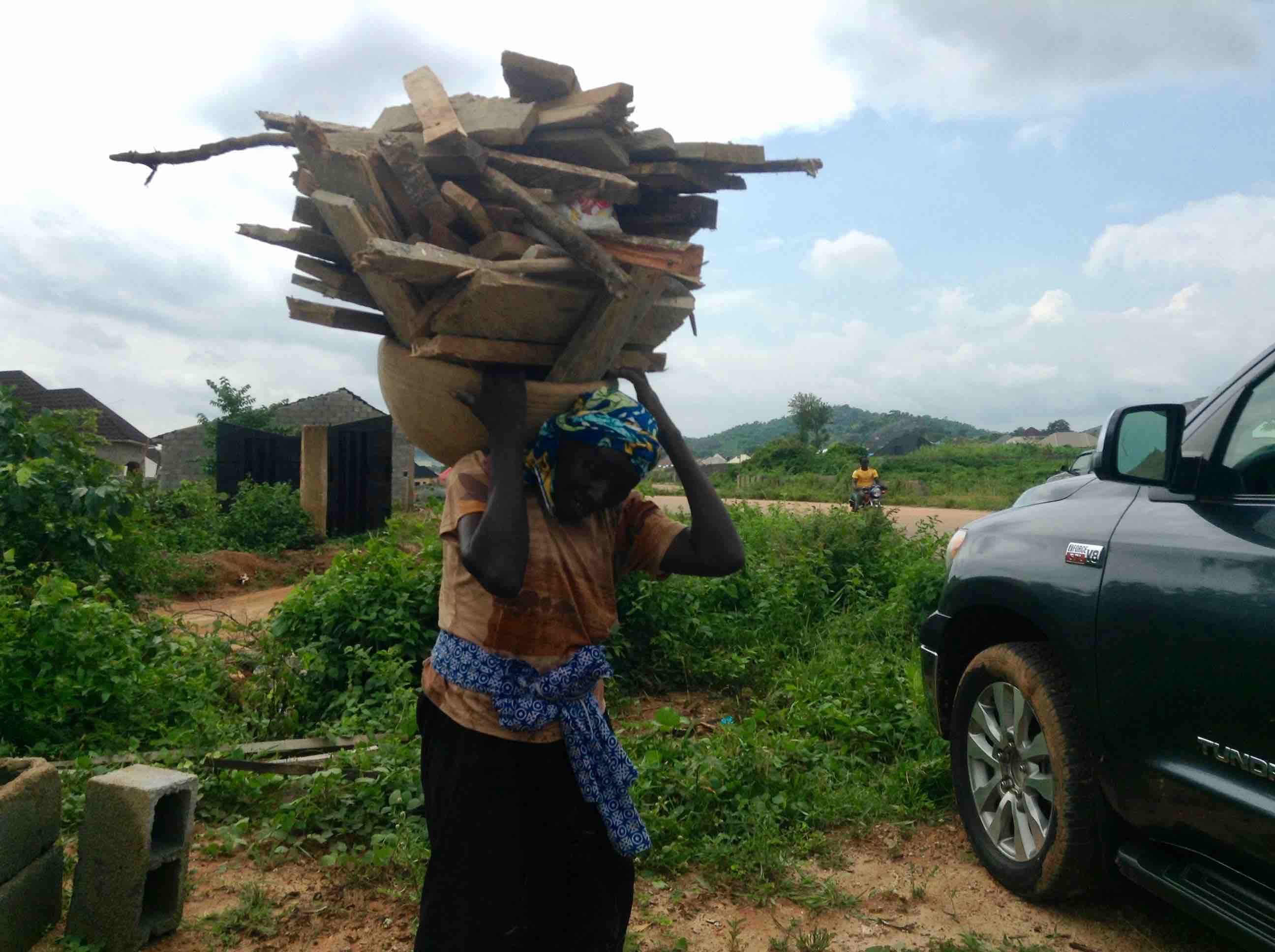 Gbagyi woman carrying a load of firewood in Ushafa Village, Abuja, Nigeria. #JujuFilms