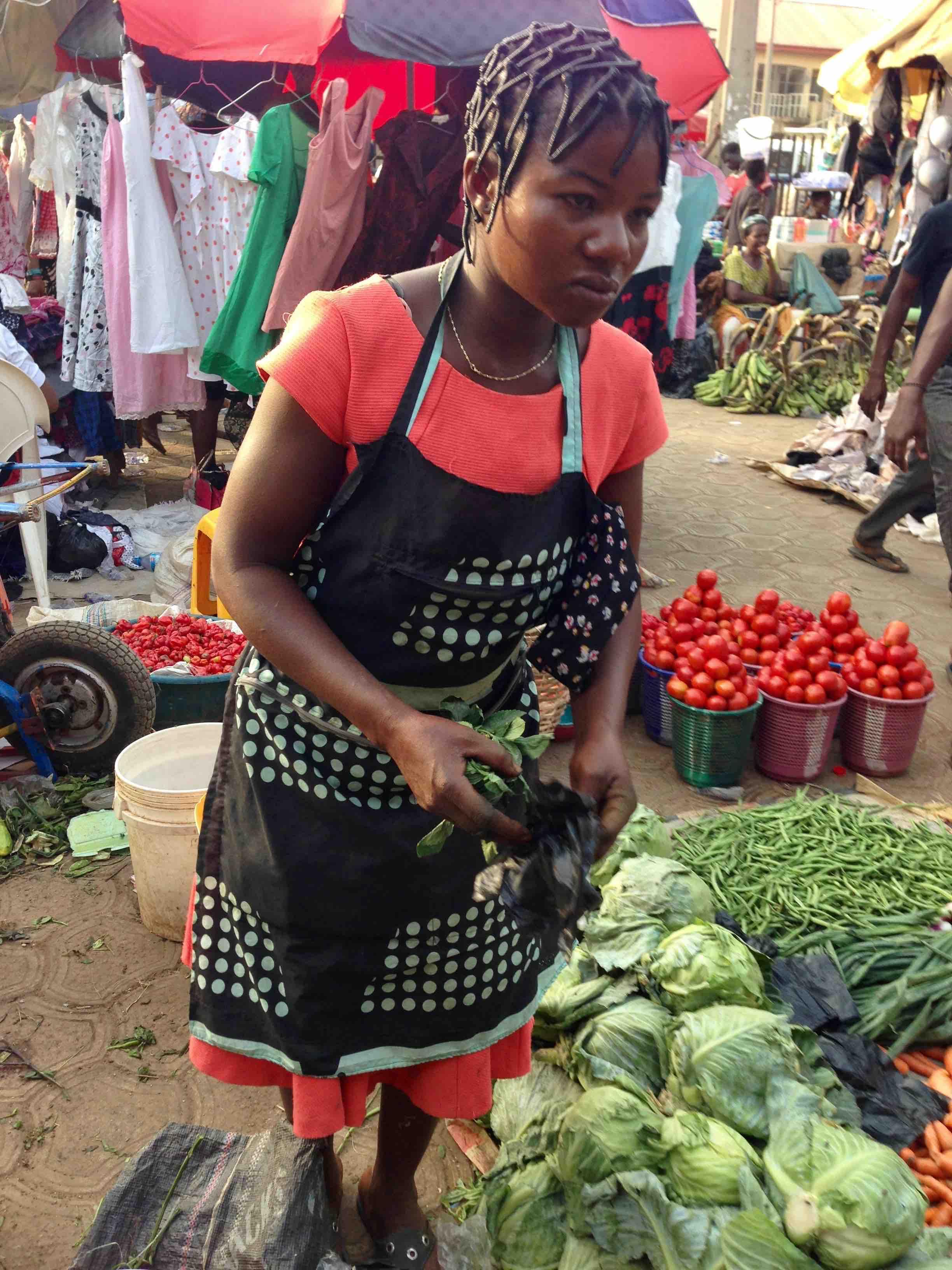 Igbo Woman selling produce in Dutse Market, Dutse, Abuja, Nigeria. #JujuFilms