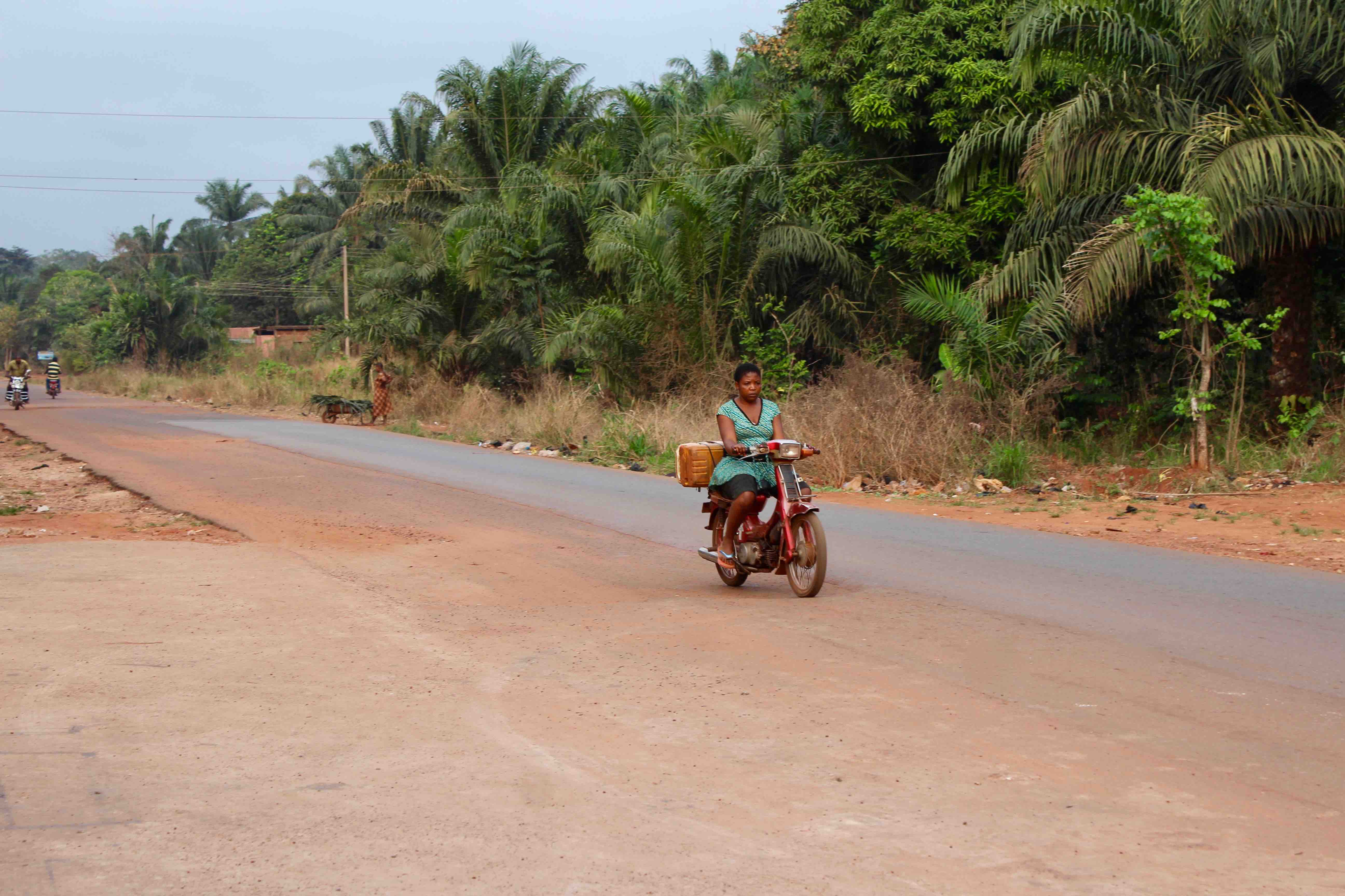 Igbo woman, motorcycling in Obolo Village, Enugu State, Nigeria. #JujuFilms