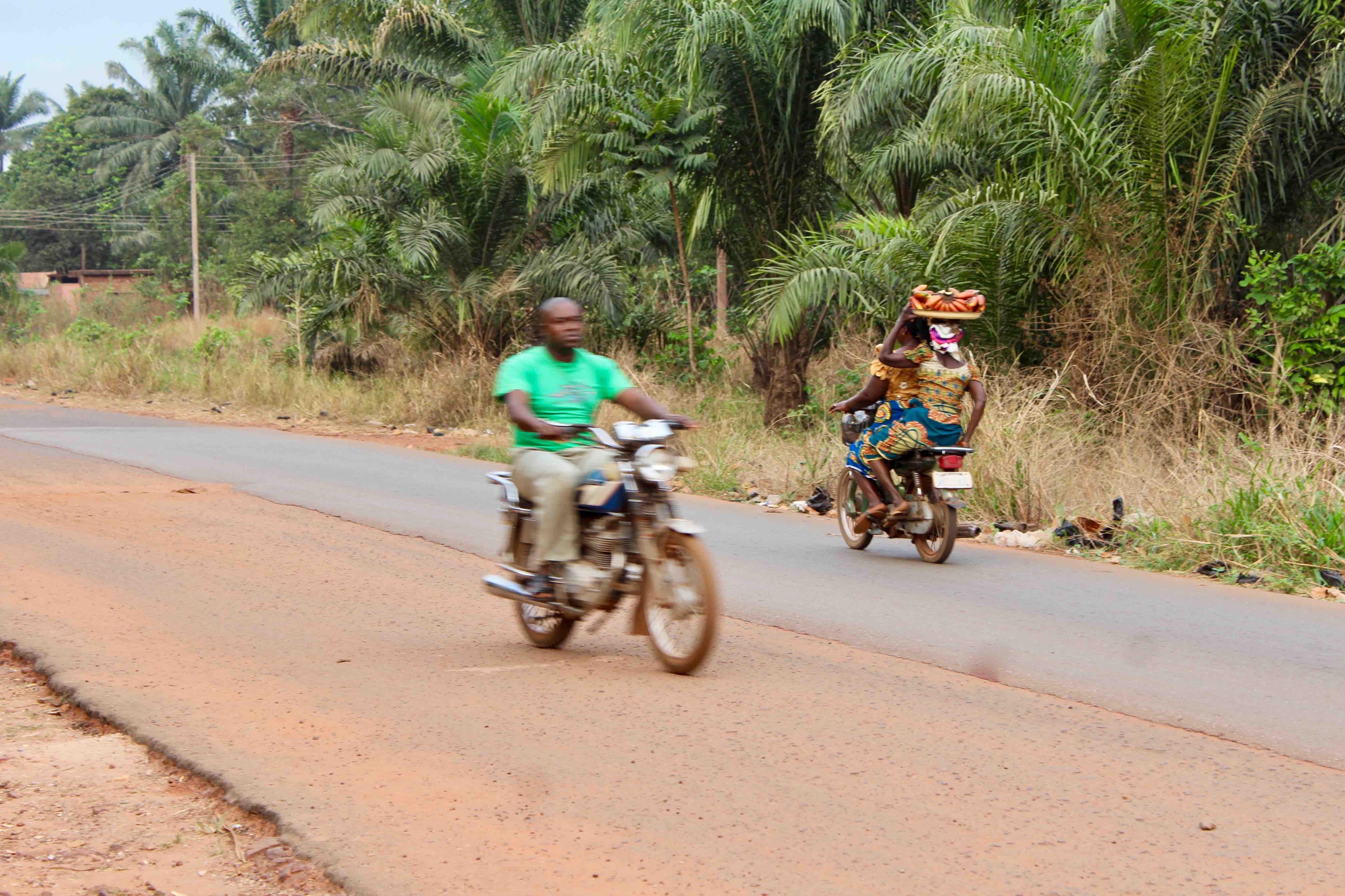 Igbo women and man, motorcycling, Obolo Village, Enugu State, Nigeria. #JujuFilms