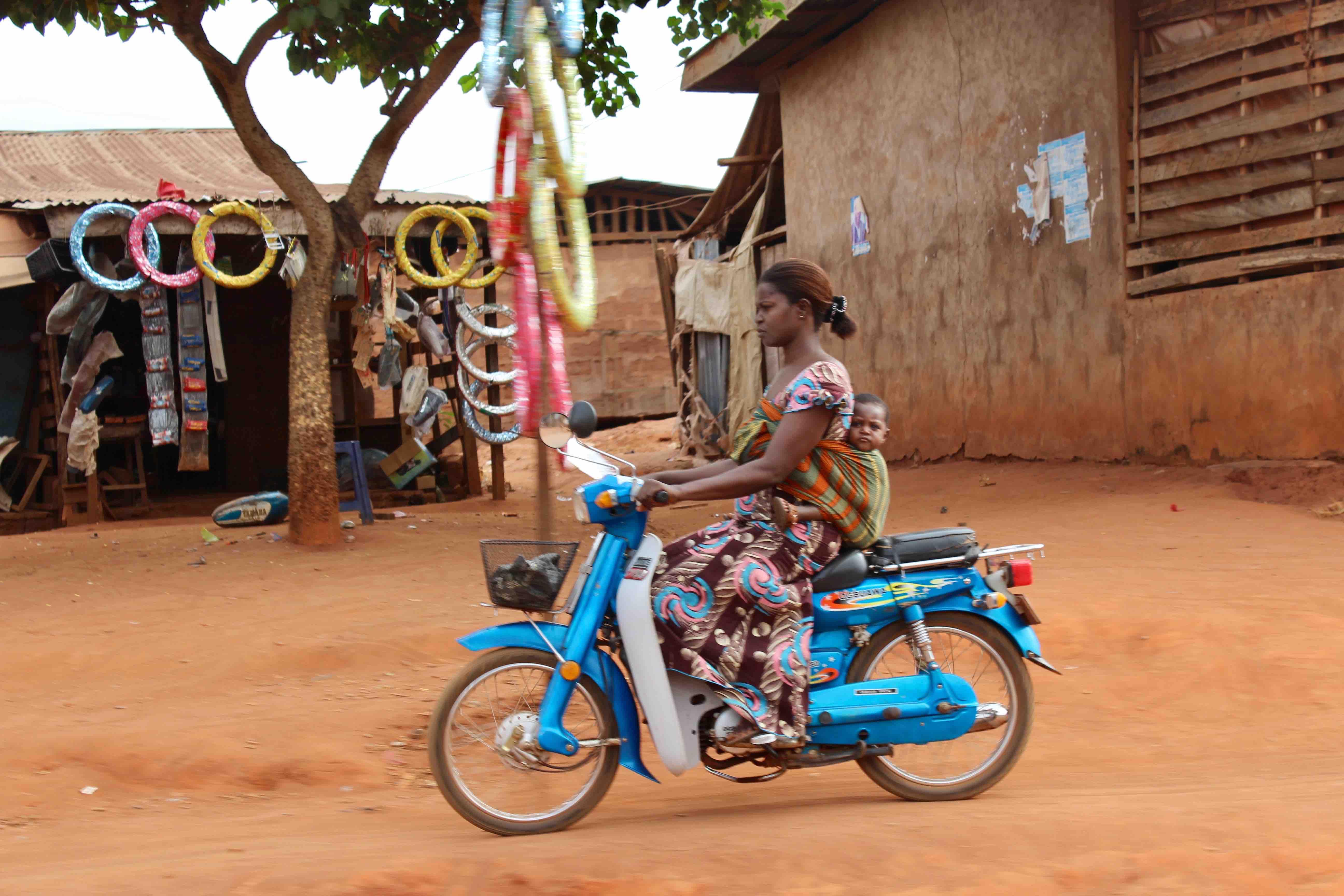 Igbo mother and child motorcycling, Iheaka Village, Enugu State, Nigeria. #JujuFilms