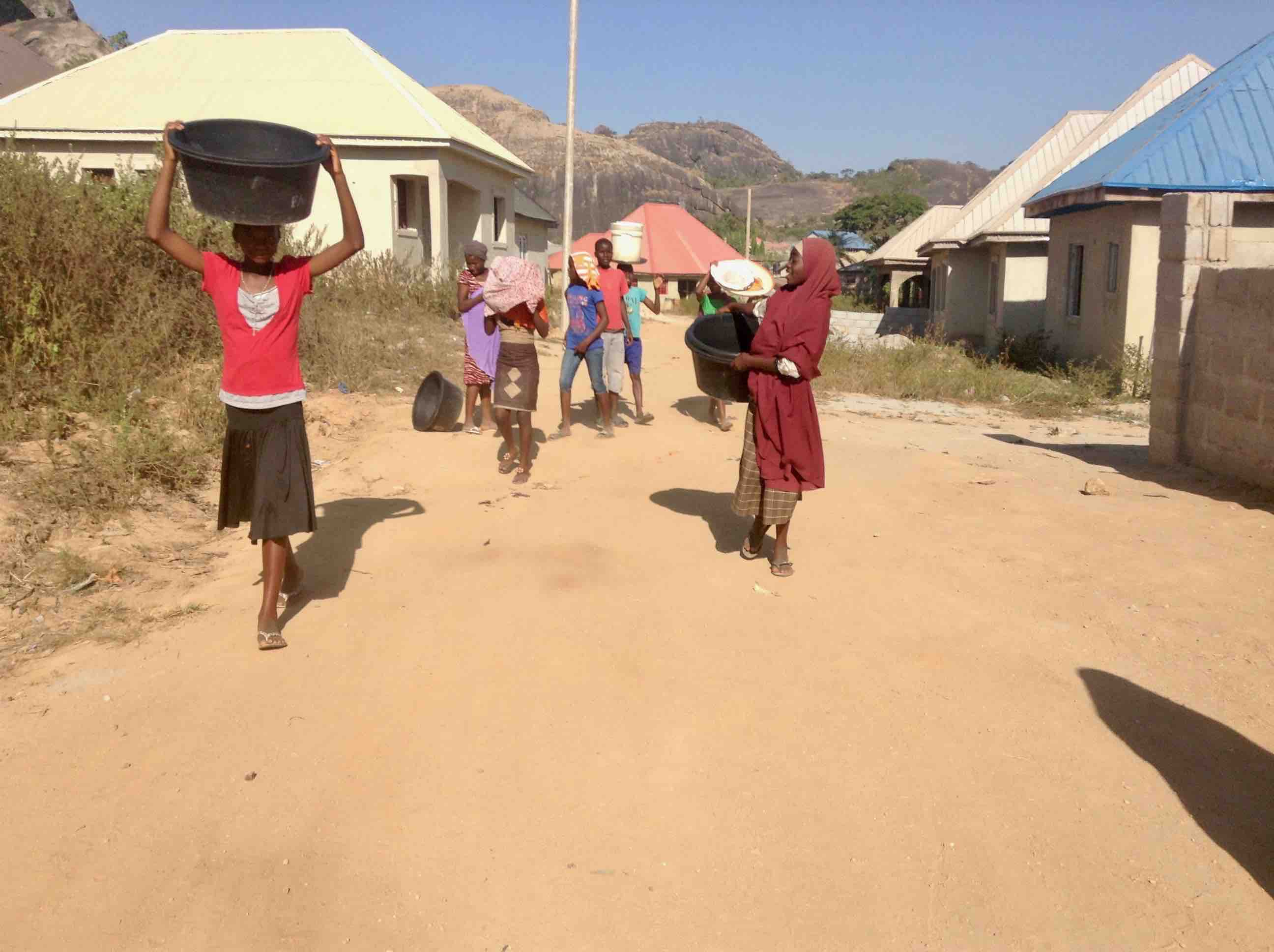 Girls fetching water in Ushafa Village, Abuja, Nigeria. #JujuFilms