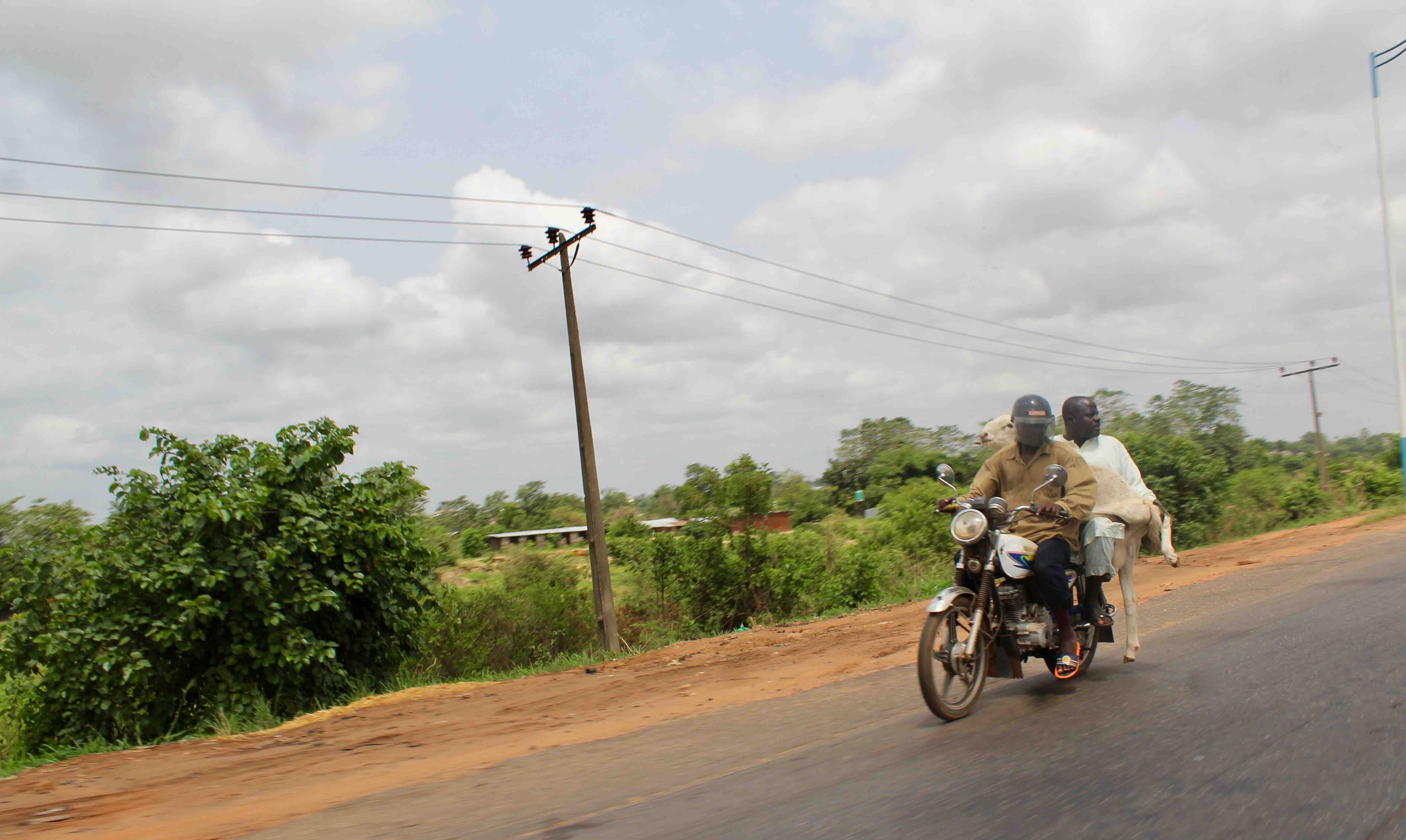 Two men and a ram riding a motorcycle, Nnewi, Anambra State, Nigeria. #JujuFilms