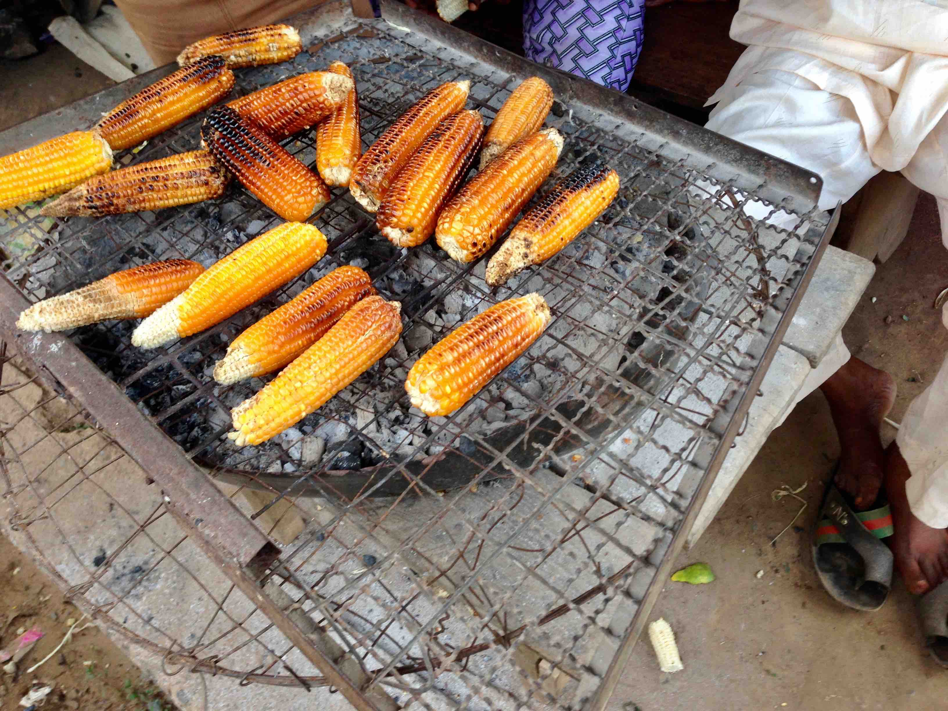 Roasting corn on open fire grill, Oke Omiru, Ilesa, Osun State, Nigeria. #JujuFilms