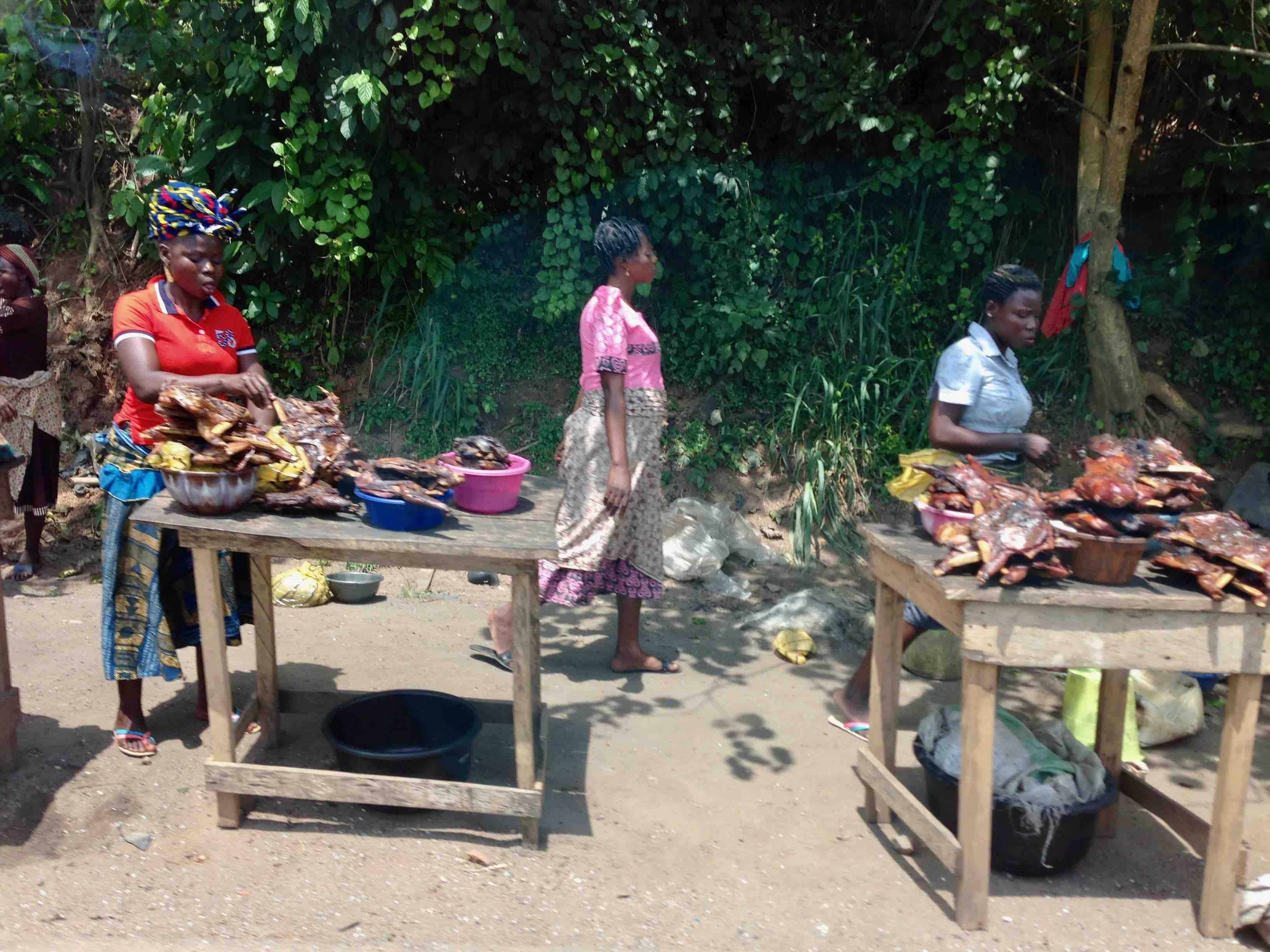 Women smoking bushmeat, Bushmeat Roadside Market, Ibadan – Ife Expressway, Osun, Nigeria. #JujuFilms