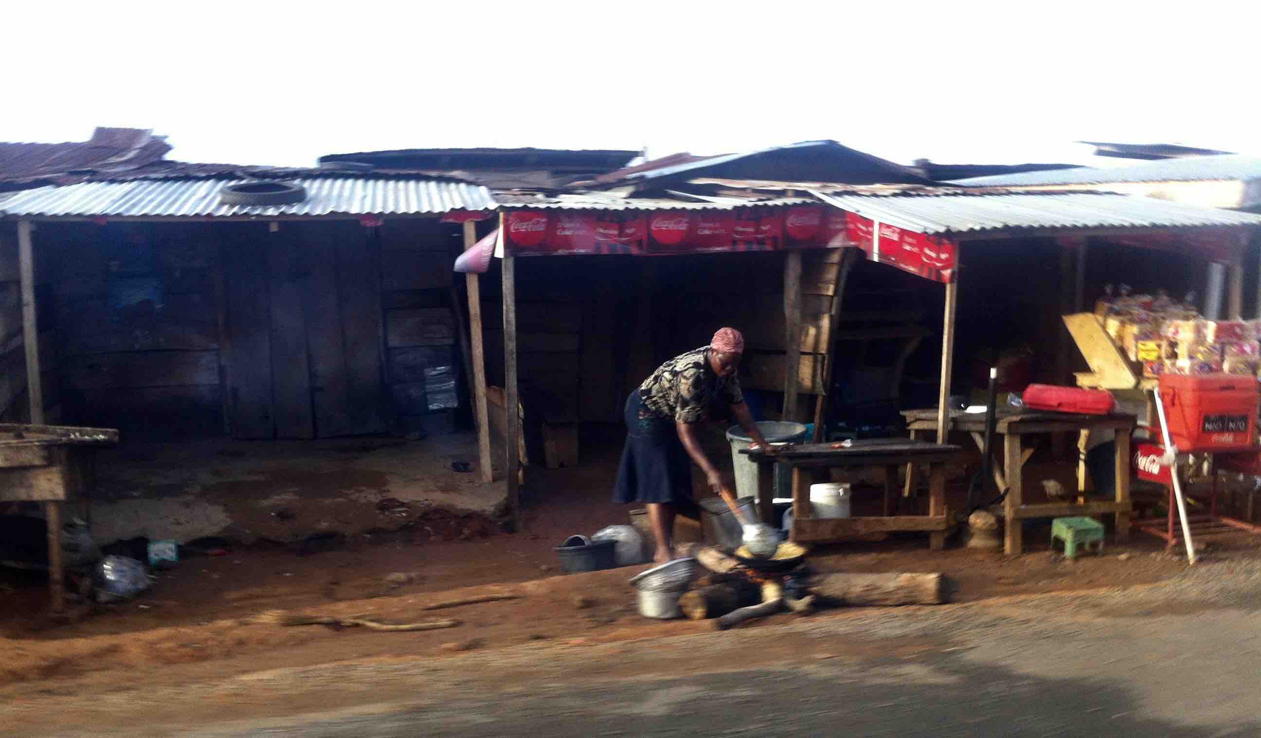 Woman frying yams by the roadside, Akure, Ondo State, Nigeria. #JujuFilms