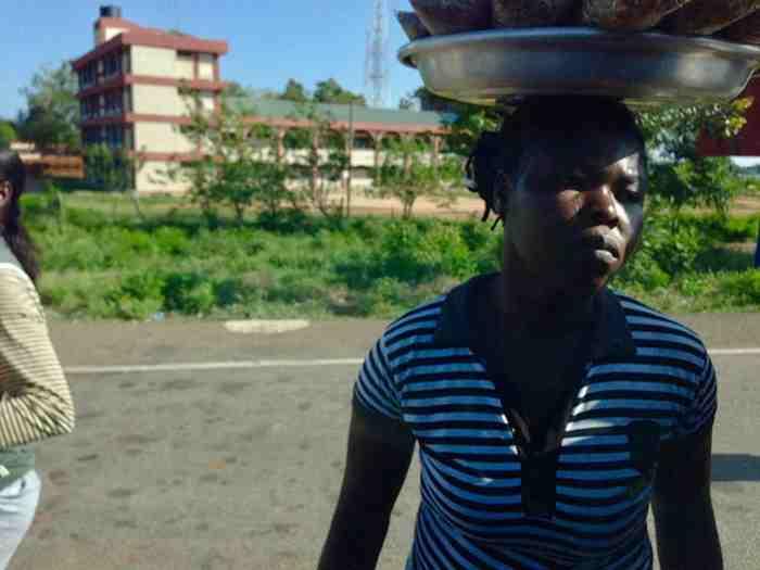 Ghanian woman, roadside hawking, Sogakope, Volta, Ghana, #JujuFilms